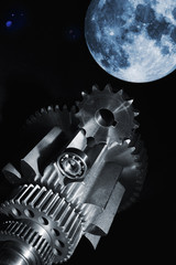 aerospace gears and cogs with full-moon in background