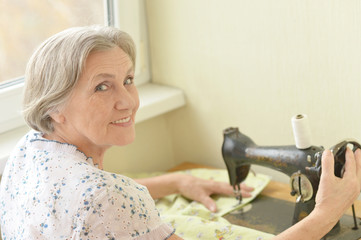 Senior woman at sewing machine
