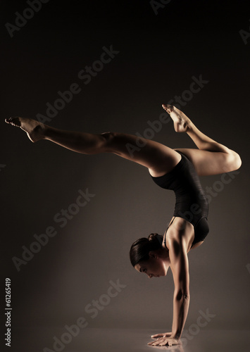woman with sportive sexy body doing acrobatic