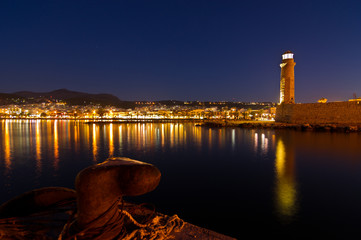 Old venetian harbor with lighthouse at twilight,Rethymno,Crete