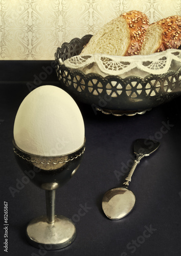 White boiled egg in silver cup