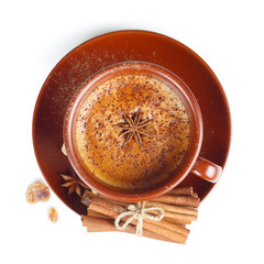 Coffee with cinnamon on a white background. Top view