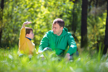 Happy father with his little son outdoors