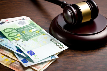 judge gavel with euro bills