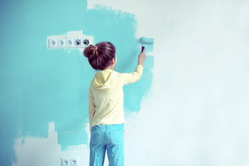 Child painting the wall
