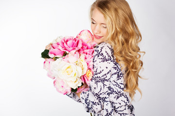 happy smiling girl with bouquet of roses