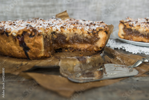 Apple pie on old, rustic, wooden table
