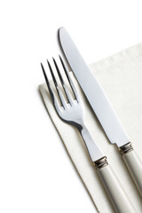 fork and knife on white napkin