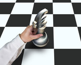 Hand locating Euro symbol piece on chessboard