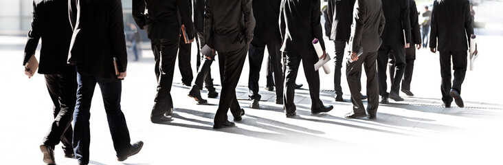 Large group of business people walking.