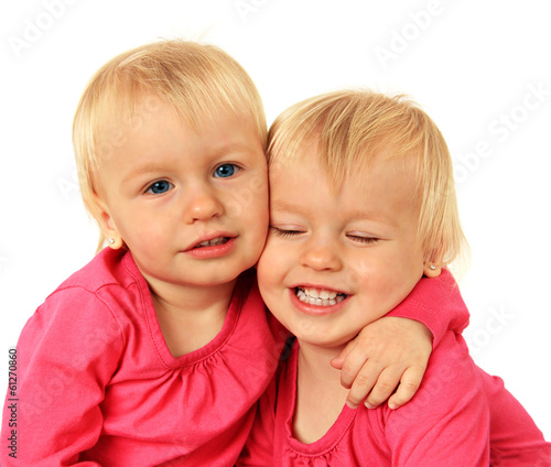 Little twin girls hugging