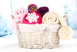 Warm knitted scarves in basket on winter background