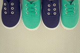 Blue and green shoes on the background with zigzags