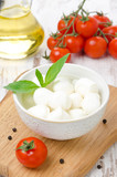 fresh mozzarella in a bowl and cherry tomatoes
