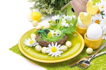Festive Easter table setting with decorations and flowers