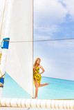 young beautiful woman on board of sea yacht, tropical sea backgr