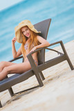 young beautiful woman relaxing on tropical beach