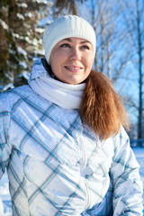 Caucasian woman in winter clothes at sunny day