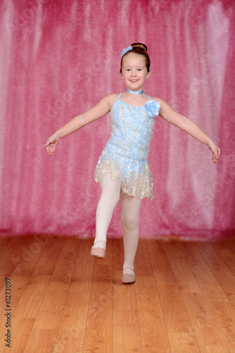 ballerina balancing on one leg