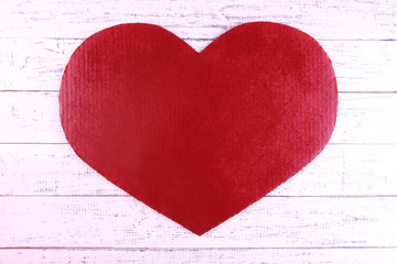 Big red heart on wooden background