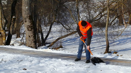 Man with a snow shovel on the sidewalk in winter episode 2