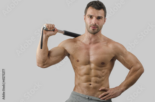 Bodybuilder training with a bendy bar,abs,chest,biceps
