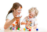 funny mother and kid girl painting together