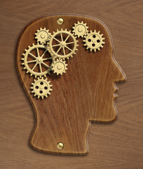 Brain wooden model made from gold metal gears and cogs
