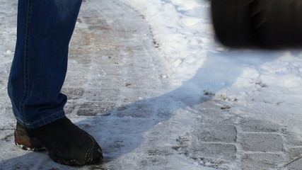 Man with a snow shovel on the sidewalk in winter episode 3