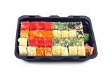 Sushi rolls with fish roe Masago in plastic container isolated