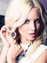portrait of beautiful girl with blond hair with jewellery