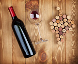Red wine bottle, glass and grape shaped corks