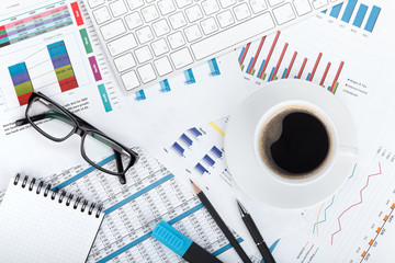 Coffee cup on financial papers