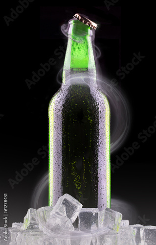 Cold beer bottle with chill smoke