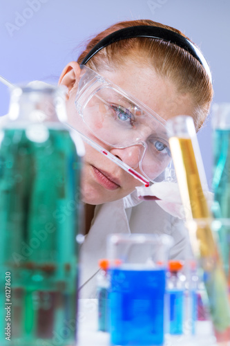 woman with test tubes in a chemistry