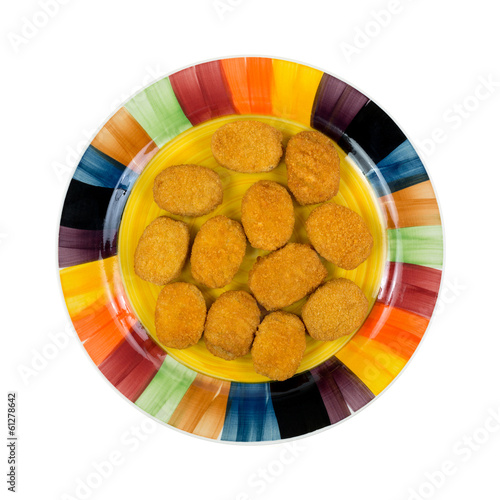 Breaded chicken nuggets on a colorful dish