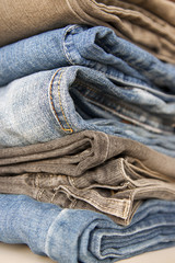 Stack of jeans in various shades