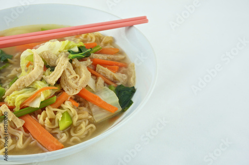 Egg noodle vegetarian with chopsticks