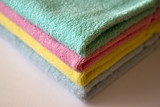 A stack of multi-colored terry towels