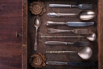 Old cutlery in an old wooden box
