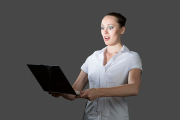 business woman holding a laptop