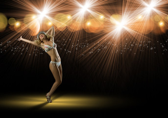 woman in bikini and hat dancing