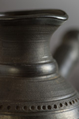 Part of Ceramic Cezve. Close up photo. Selective Focus.