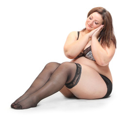 Overweight woman dressed in underwear with nylons..