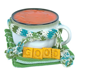 tomato soup in cup with scarf