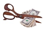 old scissors with dollars