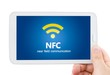 Hand holding tablet with NFC. Technology of wireless payment met