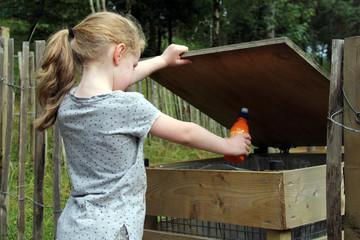 Girl throwing rubbish into bin