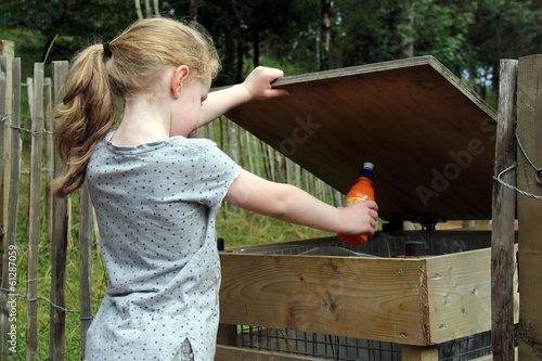 Girl throwing rubbish into bin