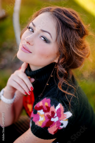 portrait of a cute brunette girl on nature background